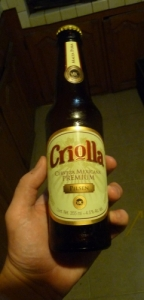 Shoddy picture of a Criolla Pilsen bottle held in a hand